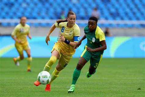 Lotta Schelin of Sweden battles for the ball with Nothando